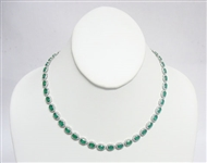 14K EMERALD AND DIAMOND NECKLACE 36.65 C.T.W.