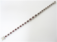 PLATINUM RUBY AND DIAMOND BRACELET 13.44 C.T.W.