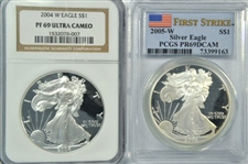 2 NEARLY FLAWLESS 2004-W (NGC) & 2005-W (PCGS) PROOF SILVER EAGLES