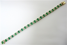 14K EMERALD AND DIAMOND BRACELET 11.22 C.T.W.